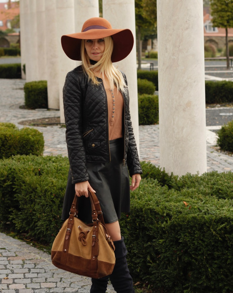city chic outfit black leather brown hat